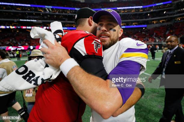 Case Keenum of the Minnesota Vikings shakes hands with Matt Schaub of the Atlanta Falcons after the game at MercedesBenz Stadium on December 3 2017...