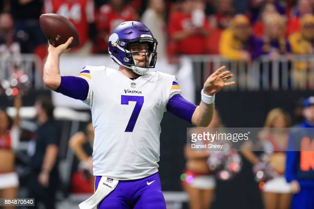 Case Keenum of the Minnesota Vikings throws a pass on the run during the first half against the Atlanta Falcons at MercedesBenz Stadium on December 3...