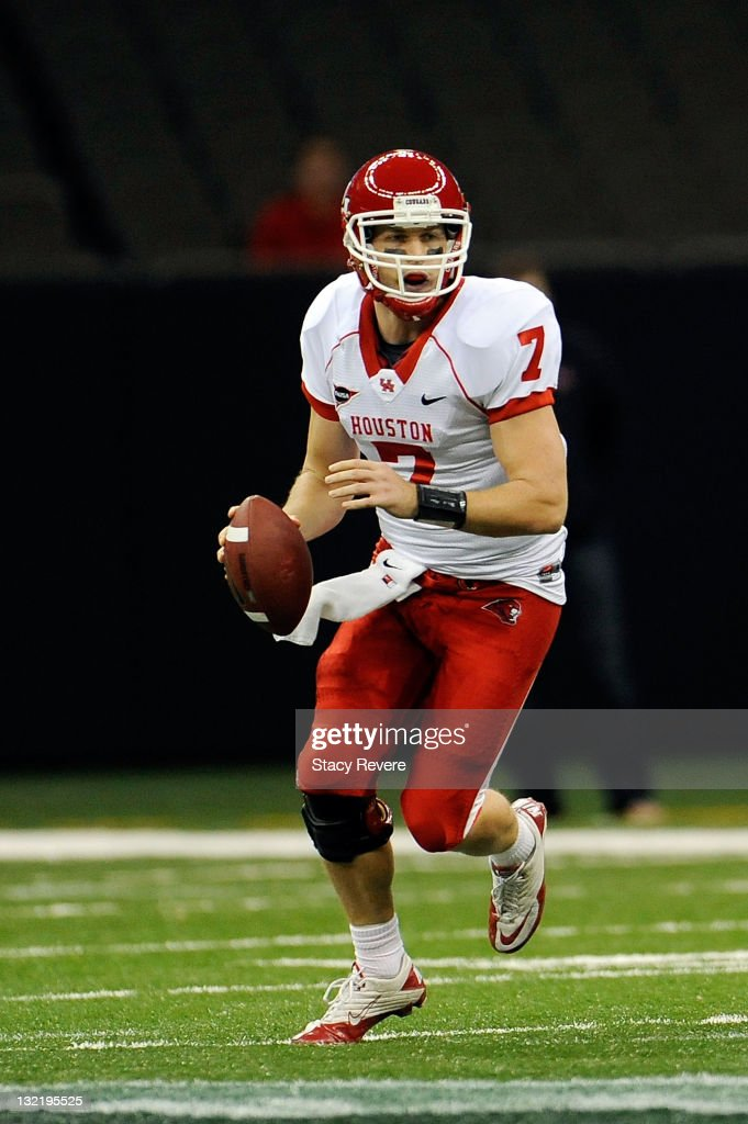 <a gi-track='captionPersonalityLinkClicked' href=/galleries/search?phrase=Case+Keenum&family=editorial&specificpeople=4650587 ng-click='$event.stopPropagation()'>Case Keenum</a> #7 of the University of Houston Cougars drops back to pass against the Tulane Green Wave during a game being held at the Mercedes-Benz Superdome on November 10, 2011 in New Orleans, Louisiana.