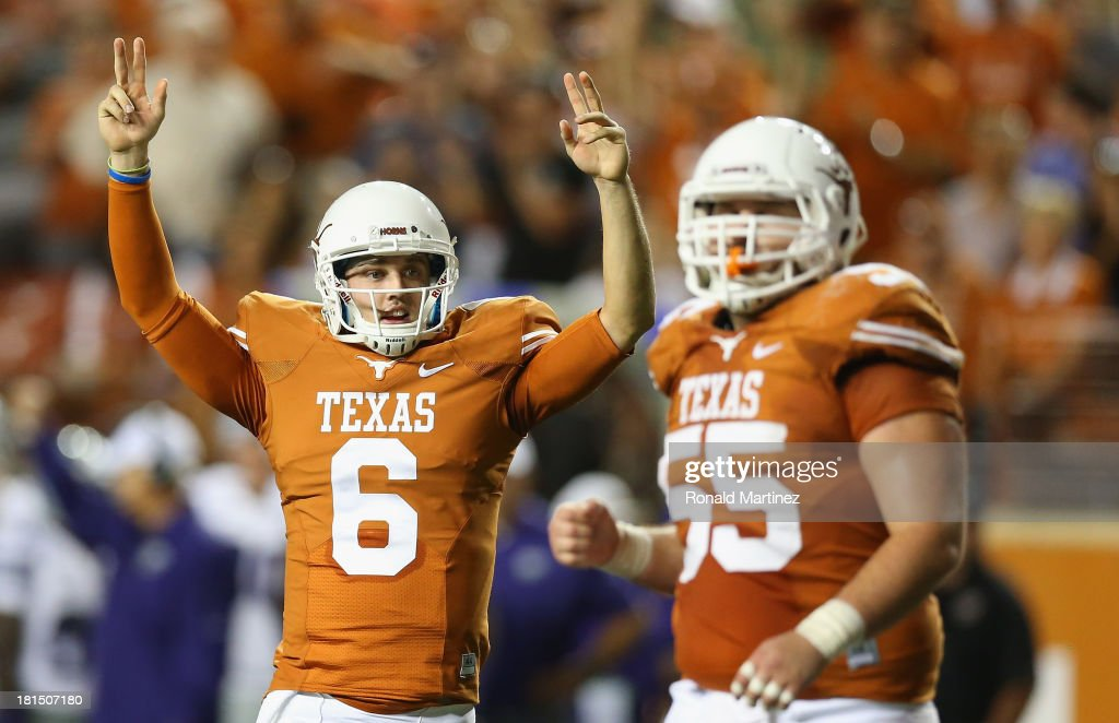 Case McCoy #6 and Dominic Espinosa #55 of the Texas Longhorns celebrate a touchdown against the Kansas State Wildcats at Darrell K Royal-Texas Memorial Stadium on September 21, 2013 in Austin, Texas.