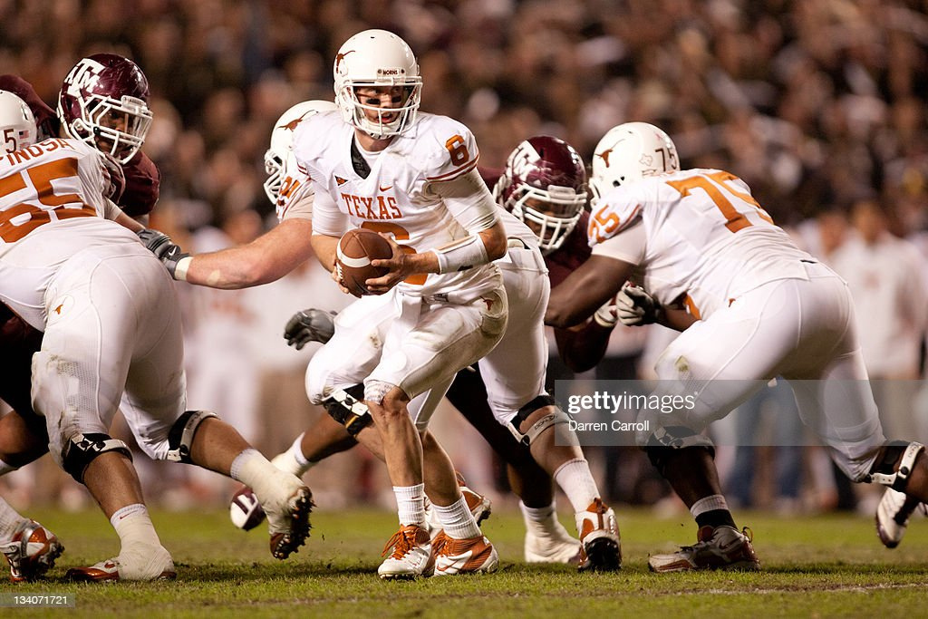 Case McCoy #6 of the Texas Longhorns looks to hand off against the Texas A&M Aggies in the second half of a game at Kyle Field on November 24, 2011 in College Station, Texas.