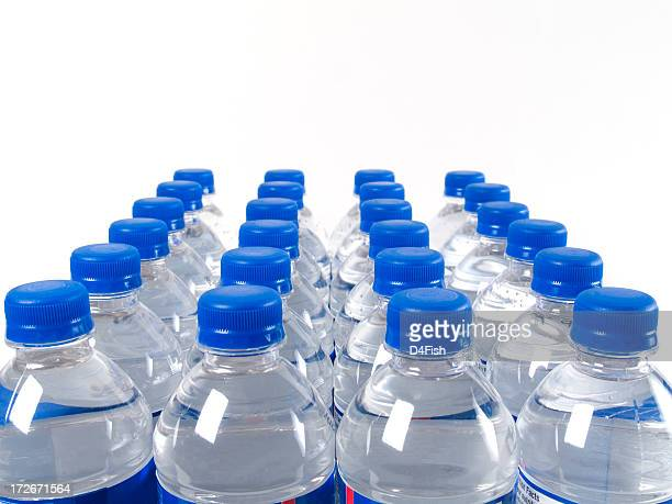 Case of filled water bottles with blue caps