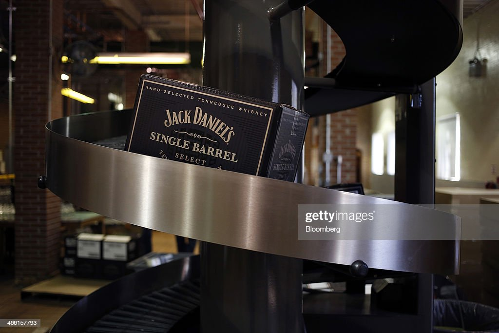 A case of Jack Daniel's Single Barrel Select Tennessee Whiskey moves up a conveyor belt at Jack Daniel's Distillery in Lynchburg, Tennessee, U.S., on Thursday, Jan. 30, 2014. Jack Daniel's is owned by Brown-Forman Corp., which announced a regular quarterly cash dividend of 29 cents per share on its Class A and Class B Common stock last week in a company press release. Photographer: Luke Sharrett/Bloomberg via Getty Images