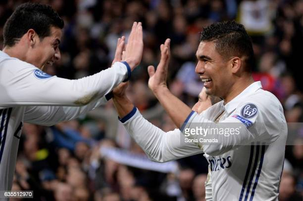 Casemiro #14 of Real Madrid celebrates after scoring his team's third goal with James Rodriguez #10 of Real Madrid during the UEFA Champions League...