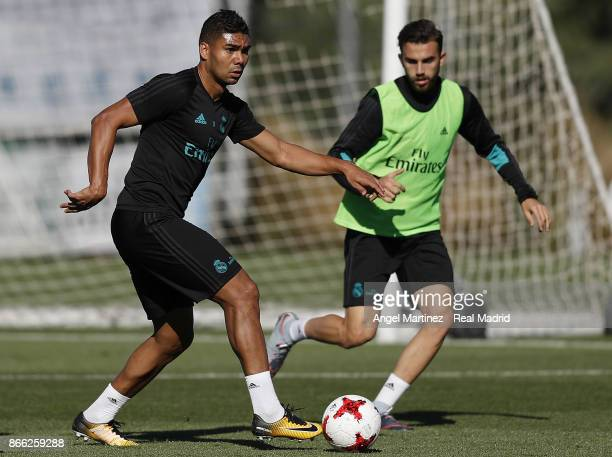 Casemiro and Borja Mayoral of Real Madrid in action during a training session at Valdebebas training ground on October 25 2017 in Madrid Spain