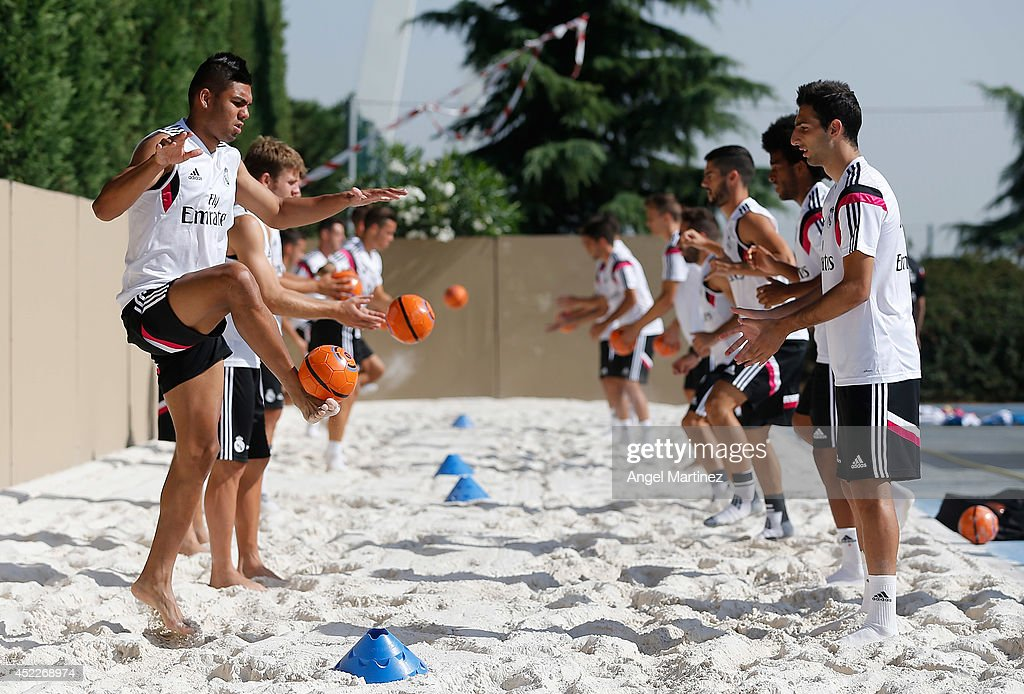 <a gi-track='captionPersonalityLinkClicked' href=/galleries/search?phrase=Casemiro&family=editorial&specificpeople=7150894 ng-click='$event.stopPropagation()'>Casemiro</a> (L) and Jose Rodriguez of Real Madrid exercise during a training session at Valdebebas training ground on July 17, 2014 in Madrid, Spain.