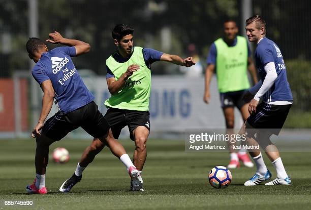 Casemiro Marco Asensio and Toni Kroos of Real Madrid in action during a training session at Valdebebas training ground on May 20 2017 in Madrid Spain