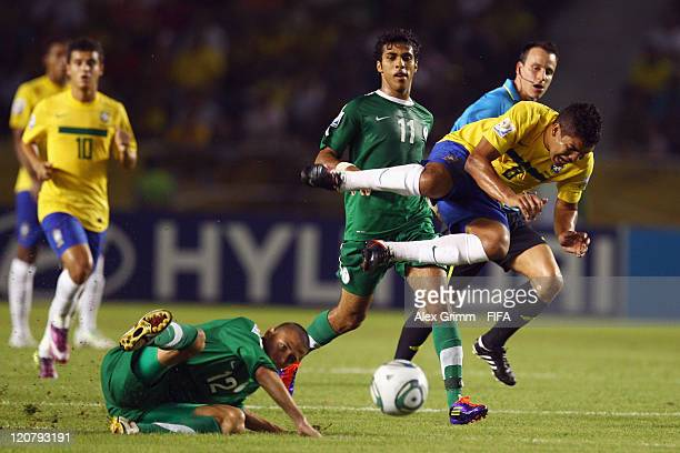 Casemiro of Brazil is challenged by Maan Khodary of Saudi Arabia during the FIFA U20 World Cup 2011 round of 16 match between Brazil and Saudi Arabia...