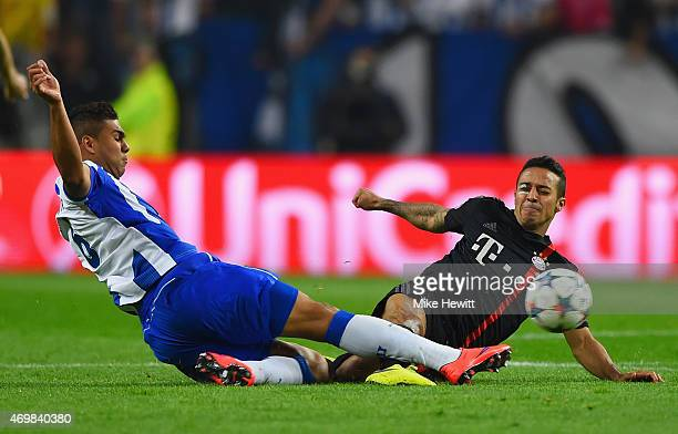 Casemiro of FC Porto and Thiago Alcantara of Bayern Muenchen battle for the ball during the UEFA Champions League Quarter Final first leg match...