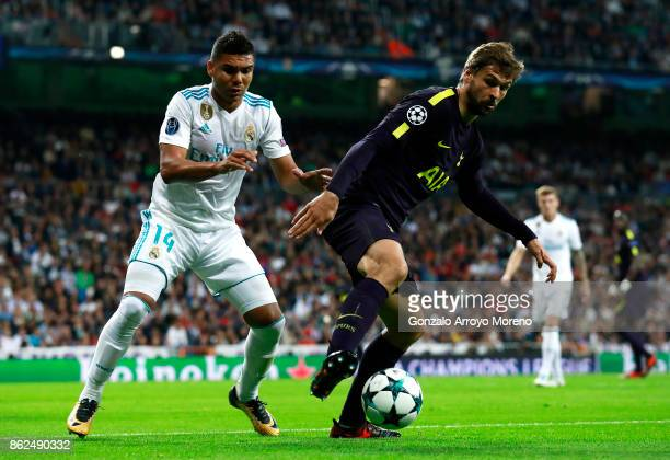 Casemiro of Real Madrid and Fernando Llorente of Tottenham Hotspur battle for possession during the UEFA Champions League group H match between Real...