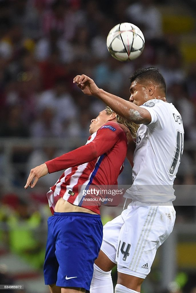 Casemiro (R) of Real Madrid and Fernando Torres (L) of Atletico Madrid vie for the ball during the UEFA Champions League Final between Real Madrid CF and Atletico Madrid at the Giuseppe Meazza Stadium in Milan, Italy on May 28, 2016.