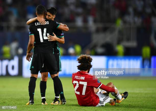 Casemiro of Real Madrid and Marco Asensio of Real Madrid celebrate victory together after Marouane Fellaini of Manchester United is dejected after...