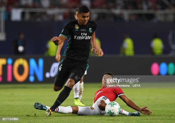 Casemiro of Real Madrid attempts to get past Jesse Lingard of Manchester United during the UEFA Super Cup final between Real Madrid and Manchester...