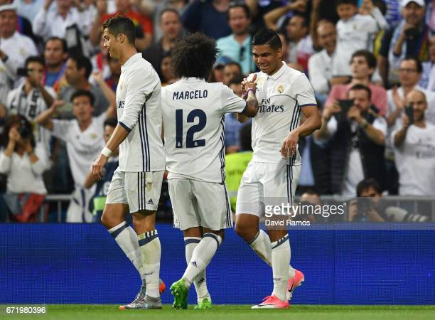 Casemiro of Real Madrid celebrates as he scores their first goal with Marcelo during the La Liga match between Real Madrid CF and FC Barcelona at...