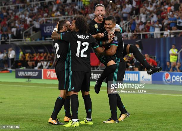 Casemiro of Real Madrid celebrates scoring his sides first goal with his Real Madrid team mates during the UEFA Super Cup final between Real Madrid...