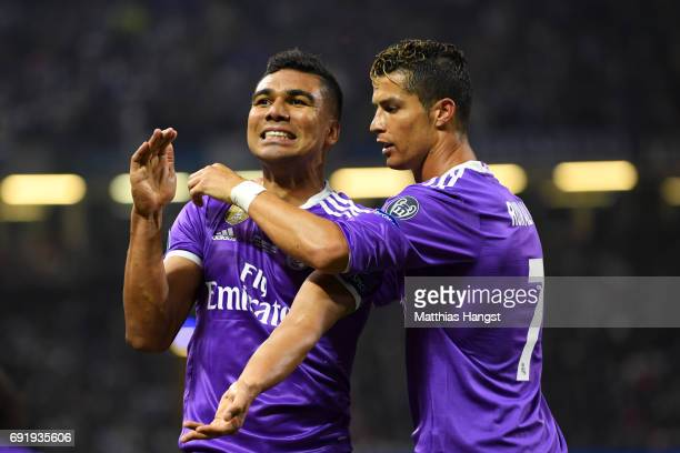 Casemiro of Real Madrid celebrates scoring his sides second goal with Cristiano Ronaldo of Real Madrid during the UEFA Champions League Final between...