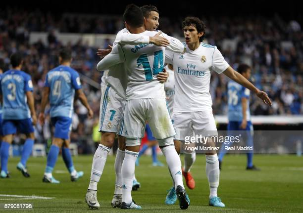 Casemiro of Real Madrid celebrates with Cristiano Ronaldo and Jesus Vallejo after scoring their team's second goal during the La Liga match between...