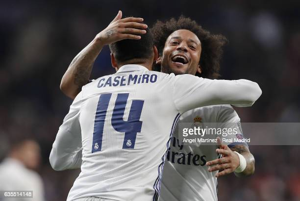 Casemiro of Real Madrid celebrates with Marcelo after scoring their team's third goal during the UEFA Champions League Round of 16 first leg match...