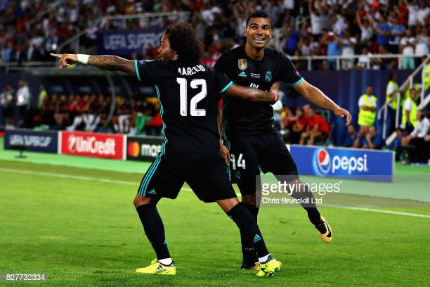 Casemiro of Real Madrid celebrates with teammate Marcelo after opening the scoring during the UEFA Super Cup match between Real Madrid and Manchester...