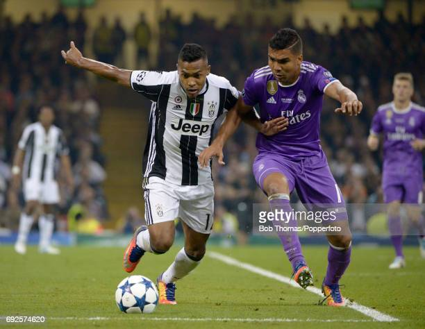 Casemiro of Real Madrid challenges Alex Sandro of Juventus during the UEFA Champions League Final between Juventus and Real Madrid at National...