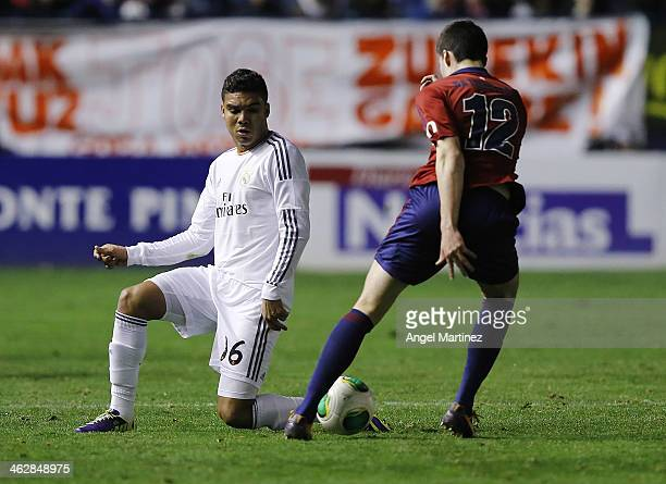 Casemiro of Real Madrid challenges Eneko Satrustegui of Osasuna during the Copa del Rey round of 16 2nd leg match between Osasuna and Real Madrid at...