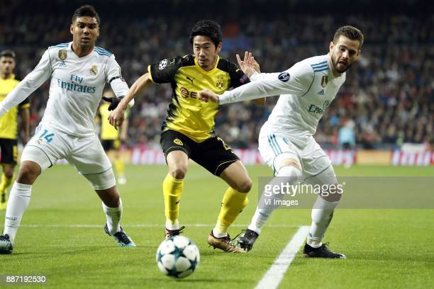 Casemiro of Real Madrid Christian Pulisic of Borussia Dortmund Nacho of Real Madrid during the UEFA Champions League group H match between Real...