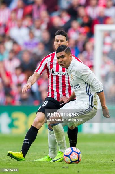 Casemiro of Real Madrid competes for the ball with Aritz Aduriz of Athletic Club during the La Liga match between Athletic Club Bilbao and Real...