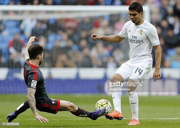 Casemiro of Real Madrid competes for the ball with Carles Planas of Celta Vigo during the La Liga match between Real Madrid CF and Celta Vigo at...