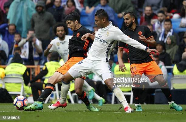 Casemiro of Real Madrid competes for the ball with Carlos Soler of Valencia CF during the La Liga match between Real Madrid and Valencia CF at...