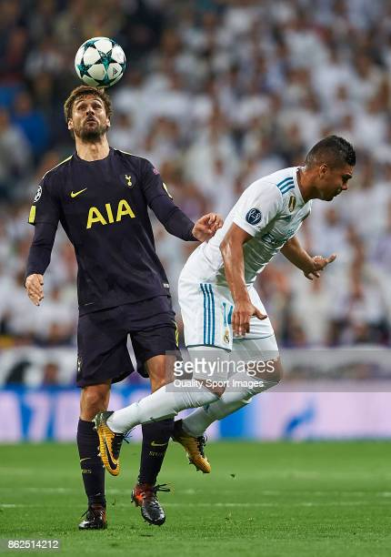 Casemiro of Real Madrid competes for the ball with Fernando Llorente of Tottenham Hotspur during the UEFA Champions League group H match between Real...