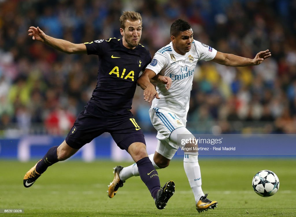 Casemiro of Real Madrid competes for the ball with Harry Kane of Tottenham Hotspur during the UEFA Champions League group H match between Real Madrid CF and Tottenham Hotspur at Estadio Santiago Bernabeu on October 17, 2017 in Madrid, Spain.