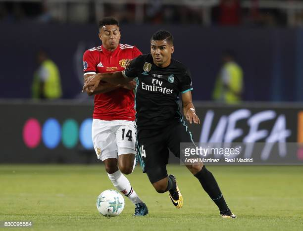 Casemiro of Real Madrid competes for the ball with Jesse Lingard of Manchester United during the UEFA Super Cup match between Real Madrid and...