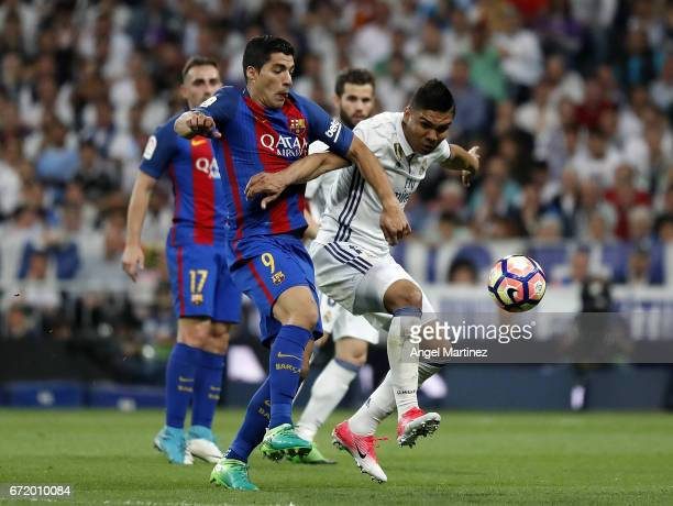 Casemiro of Real Madrid competes for the ball with Luis Suarez of FC Barcelona during the La Liga match between Real Madrid and FC Barcelona at...