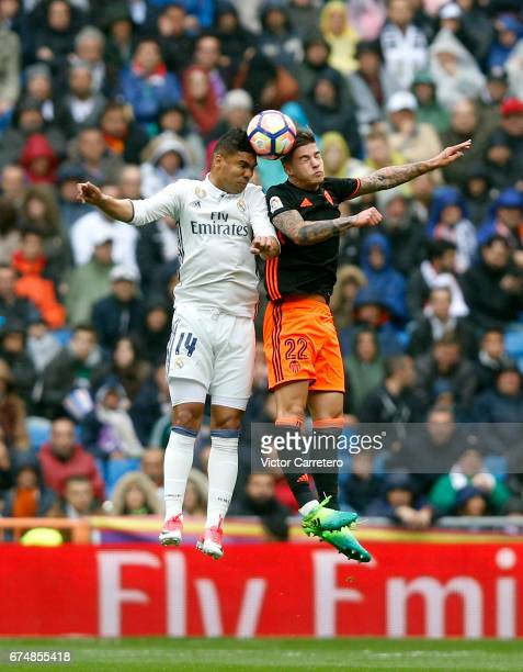 Casemiro of Real Madrid competes for the ball with Santi Mina of Valencia during the La Liga match between Real Madrid and Valencia CF at Estadio...