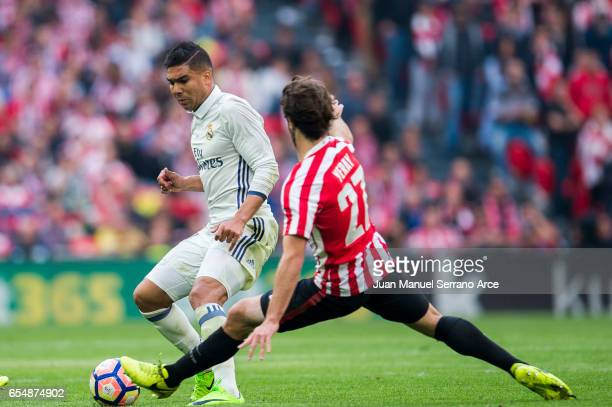 Casemiro of Real Madrid competes for the ball with Yerran Alvarez of Athletic Club during the La Liga match between Athletic Club Bilbao and Real...