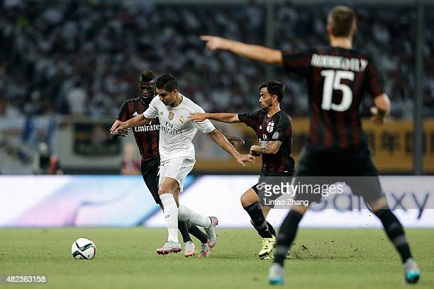 Casemiro of Real Madrid contests the ball against Suso and Niang M'baye Hamady of AC Milan during the International Champions Cup match between Real...