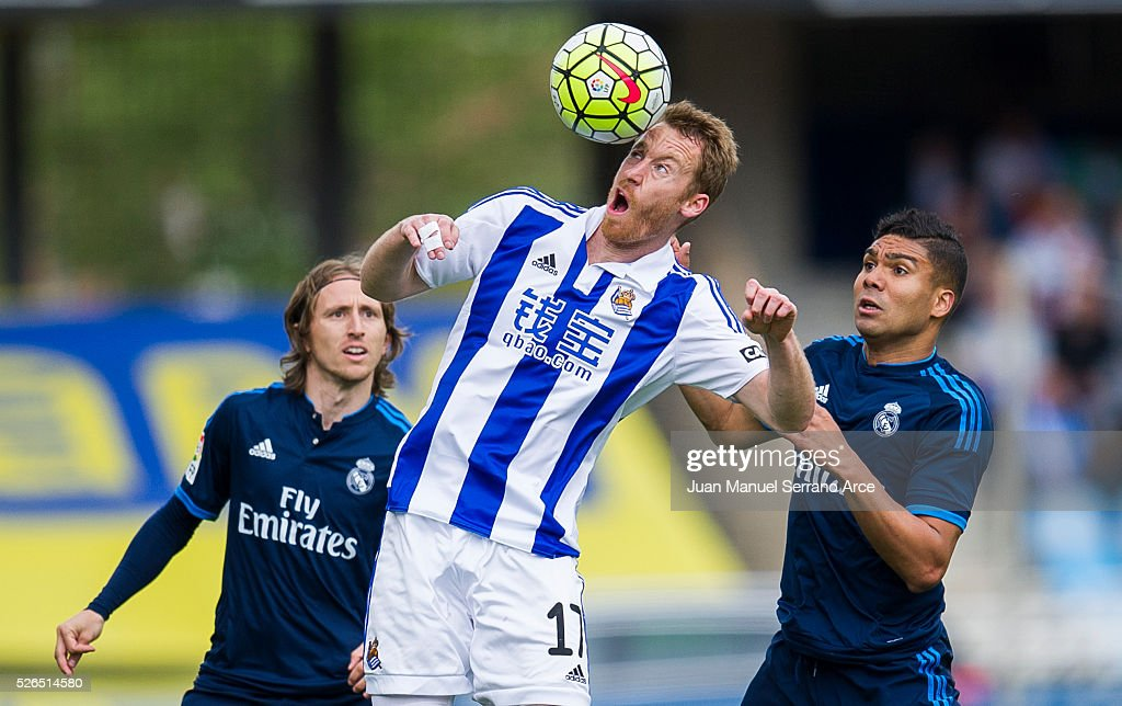 Casemiro of Real Madrid duels for the ball with David Zurutuza of Real Sociedad during the La Liga match between Real Sociedad de Futbol and Real Madrid at Estadio Anoeta on April 30, 2016 in San Sebastian, .