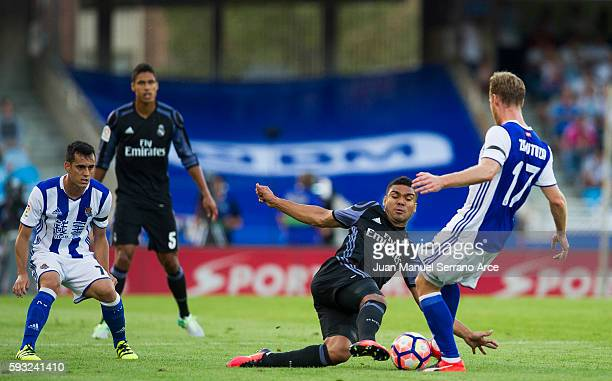 Casemiro of Real Madrid duels for the ball with David Zurutuza of Real Sociedad during the La Liga match between Real Sociedad de Futbol and Real...