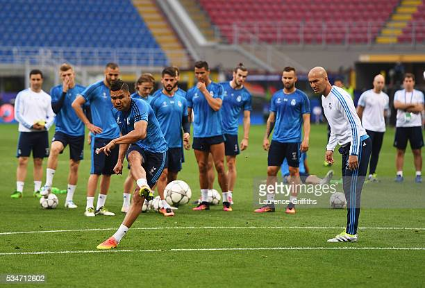 Casemiro of Real Madrid has a shot on goal as Head coach Zinedine Zidane looks on during a Real Madrid training session on the eve of the UEFA...