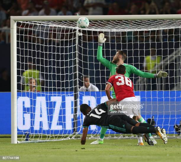 Casemiro of Real Madrid heads the ball against the bar during the UEFA Super Cup match between Real Madrid and Manchester United at Philip II Arena...