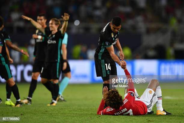 Casemiro of Real Madrid helps up Marouane Fellaini of Manchester United after the UEFA Super Cup final between Real Madrid and Manchester United at...