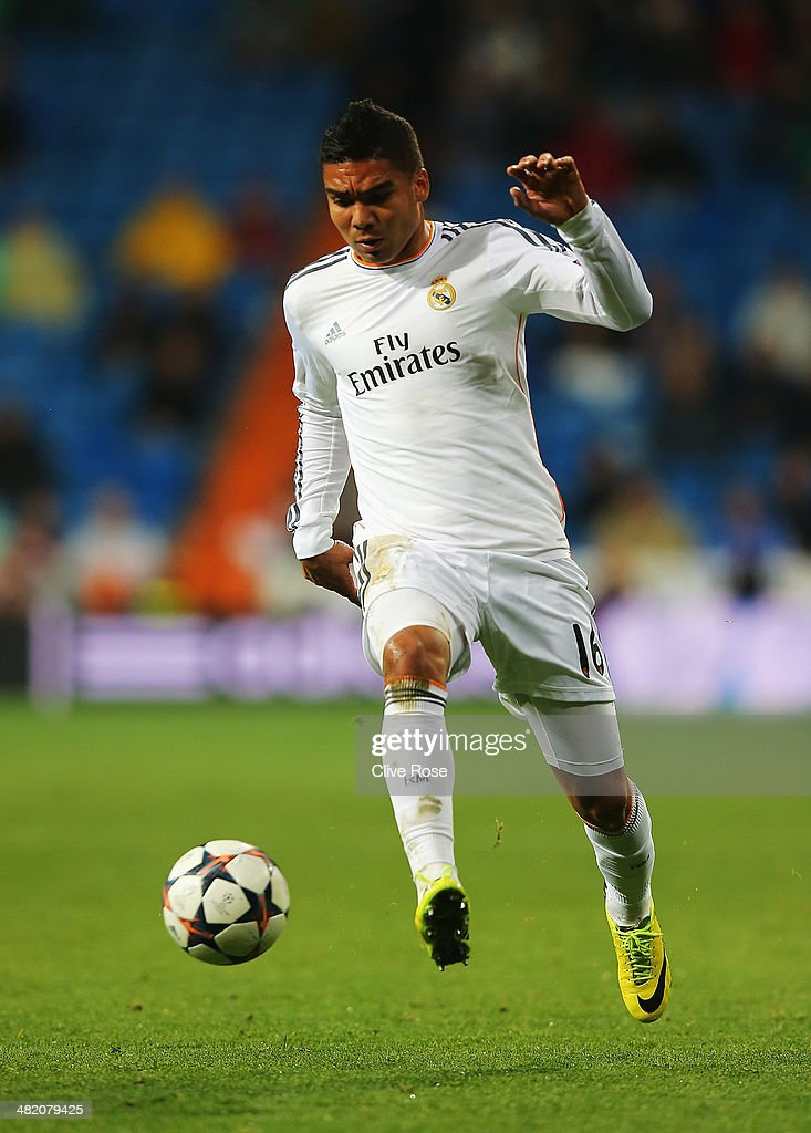 <a gi-track='captionPersonalityLinkClicked' href=/galleries/search?phrase=Casemiro&family=editorial&specificpeople=7150894 ng-click='$event.stopPropagation()'>Casemiro</a> of Real Madrid in action during the UEFA Champions League Quarter Final first leg match between Real Madrid and Borussia Dortmund at Estadio Santiago Bernabeu on April 2, 2014 in Madrid, Spain.