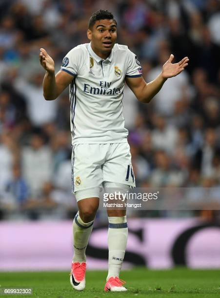 Casemiro of Real Madrid reacts to giving away a penalty during the UEFA Champions League Quarter Final second leg match between Real Madrid CF and FC...