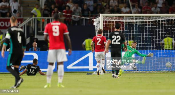 Casemiro of Real Madrid scores his sides first goal past David De Gea of Manchester United during the UEFA Super Cup final between Real Madrid and...