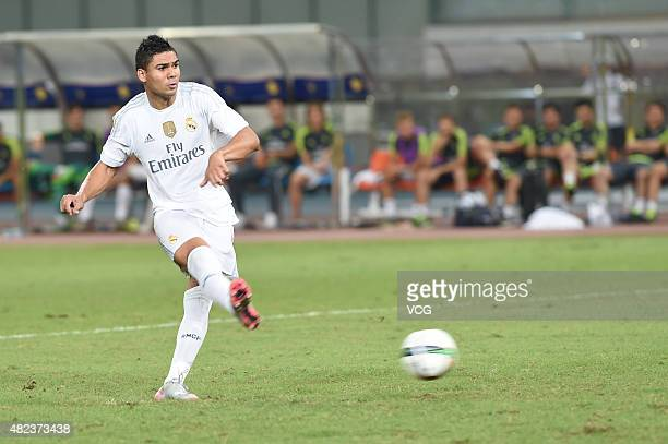 Casemiro of Real Madrid scores the third penalty kick at the penalty shootout during the International Champions Cup football match between AC Milan...