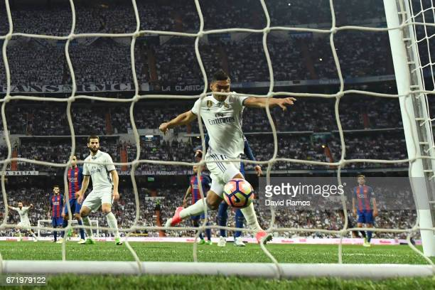 Casemiro of Real Madrid scores their first goal during the La Liga match between Real Madrid CF and FC Barcelona at Estadio Bernabeu on April 23 2017...