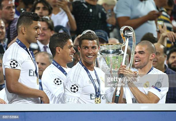 Casemiro Raphael Cristiano Ronaldo and Pepe of Real Madrid celebrate during the trophy ceremony following the UEFA Champions League final between...