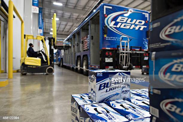 Cases of AnheuserBusch beer are loaded into a delivery truck at Brewers Distributing Co in Peoria Illinois US on Thursday Oct 30 2014 AnheuserBusch...