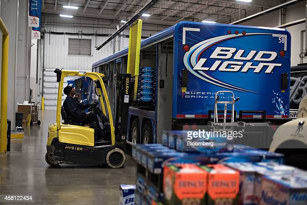 Cases of AnheuserBusch Bud Light brand beer are loaded into a delivery truck at Brewers Distributing Co in Peoria Illinois US on Thursday Oct 30 2014...