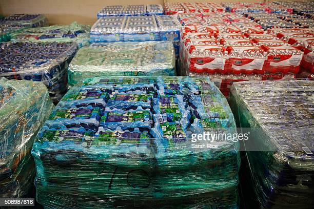 Cases of bottled water are shown at a fire station on February 7 2016 in Flint Michigan Months ago the city told citizens they could use tap water if...